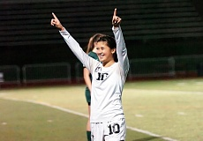 Photo Credit: DAN BROOD - WINNING SMILE -- Tualatin senior defender Natalie Shen celebrates following the Wolves' 3-1 win over Tigard in Tueday's state playoff match.