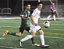 Photo Credit: MATTHEW SHERMAN - Lake Oswego's Armand Alija looks to bring down a ball in the Lakers' 3-0 victory over Wilson at home last Saturday.