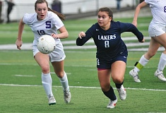 Photo Credit: MATTHEW SHERMAN - Lake Oswego's Sarah Passadore chases down a loose ball in the Lakers' playoff game at Sunset last week.