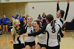 Photo Credit: JOHN WILLIAM HOWARD - St. Helens reacts after winning a point to tie the fifth and final set at eight with Summit. The Storm took a 6-0 lead in the 15-point match, but surrendered after a furious rally from the underdog Lions.
