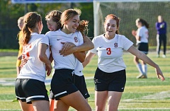 Photo Credit: JOHN WILLIAM HOWARD - Natalie Muth (center) is mobbed by teammates after scoring the Indians' first goal of the first half to put Scappoose up 1-0 on Henley.