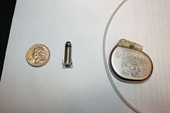 Photo Credit: CONTRIBUTED PHOTO - A Medtronic Micra Transcatheter Pacing System (middle) compares to the size of a quarter, a considerable downsize from the traditional heart pacemaker (at far right).