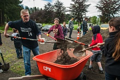 Photo Credit: SPOKESMAN FILE PHOTO: JOSH KULLA - Community volunteers work at Memorial Park during the city's annual WERK Day in May. Now, the park's master plan will be getting an overhaul with an eye on the future.