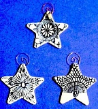 Photo Credit: SUBMITTED PHOTO - Be on the lookout for porcelain stars like these, which will be hidden around Lake Oswego from Dec. 1 to Dec. 23. Anyone who finds a star will get to keep the collectable ornament and receive a reward at the Holiday Gallery at 510 Museum and ARTspace.