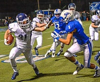 Photo Credit: JOEL TAKARSH - Devin King looks to apply a stiff arm while making a run in last week's game at Grants Pass.