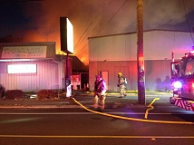 Photo Credit: PHOTO COURTESY: CLACKAMAS FIRE - Firefighters arrive Aug. 27 to 1015 Molalla Ave., Oregon City, to find heavy brown and black smoke coming from a large commercial building. They quickly went to work to locate and extinguish the fire.
