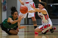 Photo Credit: THE OUTLOOK: TROY WAYRYNEN - Chardonnae Miller (30), left, of Highline College, and Lacey Updike (21) of Mount Hood Community College scramble for a loose ball. Mount Hood beat Highline 84-73.