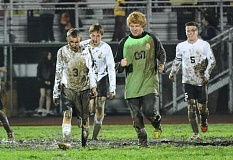 Photo Credit: FILE PHOTO - Left to right: John DeWitt, Brenden Nelson, Beau Mason and Justin Pense, react to the St. Helens boys soccer teams' cold dive into the mud as a 'celebration' of their final soccer game on the varsity football field. The soccer teams, hopefully, will play on their own soccer-specific turf field next year.