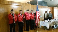 Photo Credit: DOTTIE BUSS - Members of the Tigard American Legion Post 158 Color Guard post the colors at the beginning of the Royal Villas' annual veterans' breakfast.