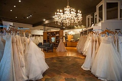 The larger space allows for easier display of gowns plus private dressing/viewing rooms and twice the space for alterations.