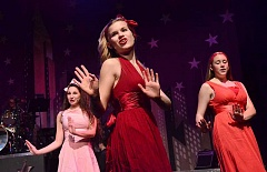 Photo Credit: REVIEW FILE PHOTO: VERN UYETAKE  - Company members performed all-male and all-female numbers during a variety show in April 2013, and many members danced and sang, including: from left, Lilly Kritler, Bethany Neuman and Emma Bartel.
