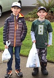 Photo Credit: SUBMITTED PHOTO - Caleb Macpherson, left, and Alex Derlago collected food with their Cub Scout troop in Wilsonville.