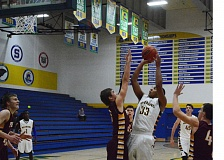 Photo Credit: TIMES PHOTO: MATT SINGLEDECKER - Aloha freshman forward Trey Hornbuckle made a big splash in his varsity debut, putting up double figure points and rebounds against Forest Grove.