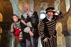 Photo Credit: PHOTO BY DAVID KINDER - Pictured are Ella DeVito, as Noelle, the time-traveling teen, Tobias Andersen, as Wizard Earl,  and Steve Black, as the Yeoman Warder. The three appear in 'Keep Magic,' the latest offering from the Portland Christmas Revels.