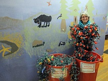 Photo Credit: NEWS-TIMES PHOTO: DOUG BURKHARDT - Master Recycler Kelly White lifts one tangled strand of old Christmas lights from the collection bin at the Forest Grove Community School, which is recycling them as a fundraiser.