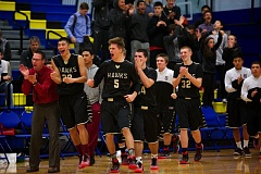 Photo Credit: PAMPLIN MEDIA GROUP: TROY WAYRYNEN - Southridge players stream off the bench to celebrate Tuesday's 59-53 double-overtime win at Barlow. The Skyhawks moved to 4-1 in nonleague action.