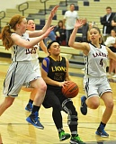 Photo Credit: MATTHEW SHERMAN - Courteney Landis makes a jump-stop during the Lions' victory over Lake Oswego last week.