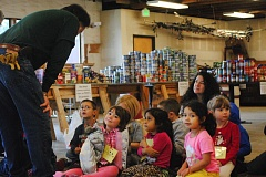 Photo Credit: HILLSBORO TRIBUNE PHOTO: STEPHANIE HAUGEN - Youngsters came to the Elks Lodge excited to see where their food donations were ending up and to help sort canned goods.