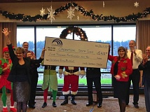 Photo Credit: PHOTO COURTESY: NCCCC - North Clackamas County Chamber of Commerce Board Chairwoman Angela Fox, publisher of the Clackamas Review/Oregon City News, celebrates the large donation with Chamber CEO Laura Edmonds.