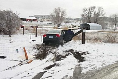 Photo Credit: SUBMITTED PHOTO - A vehicle stolen from Warm Springs was crashed into a fence in Gateway, following a police chase. The occupants fled the scene, but were later arrested.