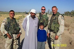 Photo Credit: COURTESY PHOTOS - Ed Winkler (right), a member of the Oregon Army National Guard, used his business skills to communicate with Iraqi people.
