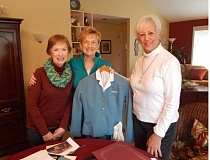 Photo Credit: BARBARA SHERMAN - Sue Mattecheck (left), Barb Lance, holding her 1960s' United Airlines uniform, and Pat Dufort have fun reminisicing about their high-flying days.