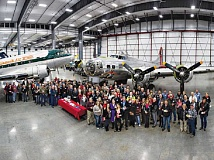 Photo Credit: LYLE JANSMA - ERICKSON AIRCRAFT COLLECTION - The Dec. 18 Business After Hours event drew a crowd of people to the new Erickson Aircraft Collection facility, where they posed next to the 'Madras Maiden' B-17.