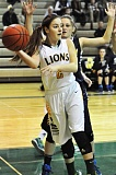 Photo Credit: MATTHEW SHERMAN - West Linn freshman Kennedi Byram saves a ball along the baseline during the Lions' overtime victory over Canby on Tuesday. Byram started the game and had her team's first two baskets.