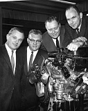 Photo Credit: COURTESY METRO PORTLAND NEW CAR DEALERS ASSOCIATION - Auto dealers gathered around what was then a new engine are (from right) Chuck Wentworth, Linn Kirby,and Fred Bauer,Sr.