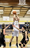 Photo Credit: SETH GORDON - NHS comes up just short -- Sabrina Salmons pulls up for a jumper in the Tigers' 48-46 loss to Canby at home Jan. 8.