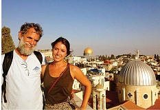 Photo Credit: SUBMITTED PHOTO - Miriam Fisher, of Madras, escorts her father, Steve Fisher, on a tour of the old city of Jerusalem, when he visited in August. The Dome of the Rock is in the background.