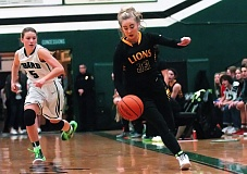 Photo Credit: DAN BROOD - West Linn's Sidney Kolasinski skirts the sideline on a fast break in West Linn's game against Tigard last week. The Lions fell to the Tigers before giving St. Mary's a battle on Tuesday.