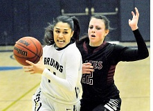 Photo Credit: SETH GORDON - Turning the corner - Samantha Naluai breezes past a Whitworth defender during George Fox's emphatic 70-39 victory over the previously unbeaten Pirates. Naluai had eight points and four rebounds for the first-place Bruins.