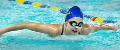 Photo Credit: SETH GORDON - Winging it - Grace Kavanagh races in the 100 butterfly in a dual meet against Canby Jan. 15 at the Chehalem Aquatic Center. The Tigers won the meet 98-72.