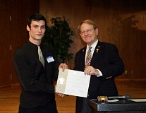 Photo Credit: COURTESY PHOTOS: BLAKE TIMM - Pacific University Rotaract Club President Jacob Richards (left) was presented with the clubs charter by Rotary District 5100 Governor Doug Taylor Sunday, Jan. 18.