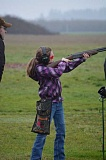 Photo Credit: HILLSBORO TRIBUNE PHOTOS: KATHY FULLER - Lanaya Clapshaw, 10, takes aim at a clay target during a junior trap shoot league competition at Hillsboro Trap & Skeet Club as her dad, Sam Clapshaw, offers her some tips.