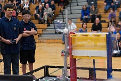 Photo Credit: SUBMITTED PHOTO - Team Axis robot, Oscar, lifts and drops balls into an elevated container during a competition. Colin Mitchell operates the robot while Owen Chu helps with strategy.