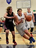Photo Credit: VERN UYETAKE - Julianna Ramey drives against a Tualatin defender in Tuesday's victory over the Timberwolves. Ramey led her team in scoring with 12 points.