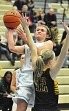 Photo Credit: MATTHEW SHERMAN - Lakeridge's Natalie Bristol finds some room to get a shot off in the Pacers' game against West Linn at home last week.