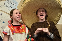 Photo Credit: REVIEW PHOTO: VERN UYETAKE - From left, Cara Starke and Kendryn Starke participate in a Spanish performance during the Sailor Showcase.