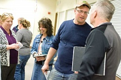 Photo Credit: KEVIN SPERL - Hampton resident Dave Baker talks with school board Chair Doug Smith, far right, during an open discussion in Brothers about reopening the rural school. Mona Boyd, back left, Crook County School District Director of Special Education, who would take on the role of the school's principal, talks with Prineville resident Arlene Bolin.