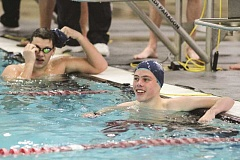 Photo Credit: HILLSBORO TRIBUNE PHOTO: AMANDA MILES - Liberty's Max Woodbury smiles after leading teammate Jake Soelberg (background) to a 1-2 finish in the boys 100-yard breaststroke at Saturday's NWOC district swimming meet.