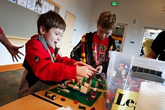 Photo Credit: TIMES PHOTO: JONATHAN HOUSE  - Henry Zastrow and his brother Chris enjoy building with Legos during a meeting of the Lego Maniacs Club at Tualatin Public Library.