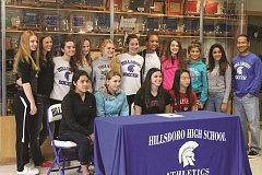 Photo Credit: HILLSBORO TRIBUNE PHOTO: AMANDA MILES - Sami Moellmer's team joins her for a signing ceremony