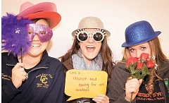Photo Credit: PHOTO CONTRIBUTED BY MAGGIE CAMPE - Part of the local awareness effort includes photo booth pictures that ask teens what love means to them.