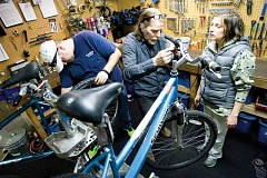Photo Credit: KEVIN SPERL - Michael Martin, center, co-owner of Bicycle Re-Source of Bend, works with volunteers Chris Goodwin, left, of Redmond, and Debbie Pattison, of Bend, to refurbish bikes at their location in Bend. The nonprofit will host a free bike clinic on Sunday with James Good of Prineville's Good Bike Company at the Crook County Fairgrounds on Sunday.