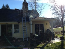Photo Credit: SUBMITTED PHOTO - Crews worked this morning to put out a residential fire in rural Tualatin.