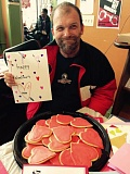 Photo Credit: PHOTO COURTESY: LESLIE ROBINETTE - A homeless man shows off a Valentine card made by a third grade student at John Wetten Elementary in Gladstone.