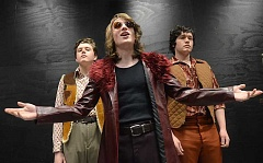 Caesar, played by Evan Shely, is flanked by Cassius, left, played by Hugh Sherman, and Brutus, right, played by Gabe Britt, onstage in WLHS's Black Box Theatre.