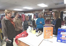 Photo Credit: BARBARA SHERMAN - Standing in the Caring Closet's shopping area, Director Rose Money (right) tells Summerfield residents (from left) Sandy Brewer, Jan Meek, Carole Krueger and Cheryl Baldwin about the facility and how it helps families in need.